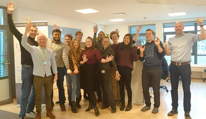 Cerebriu Celebrates receiving CE-mark. Group photo containing members of the Cerebriu team raising their hands and smiling in celebration of the CE-marking